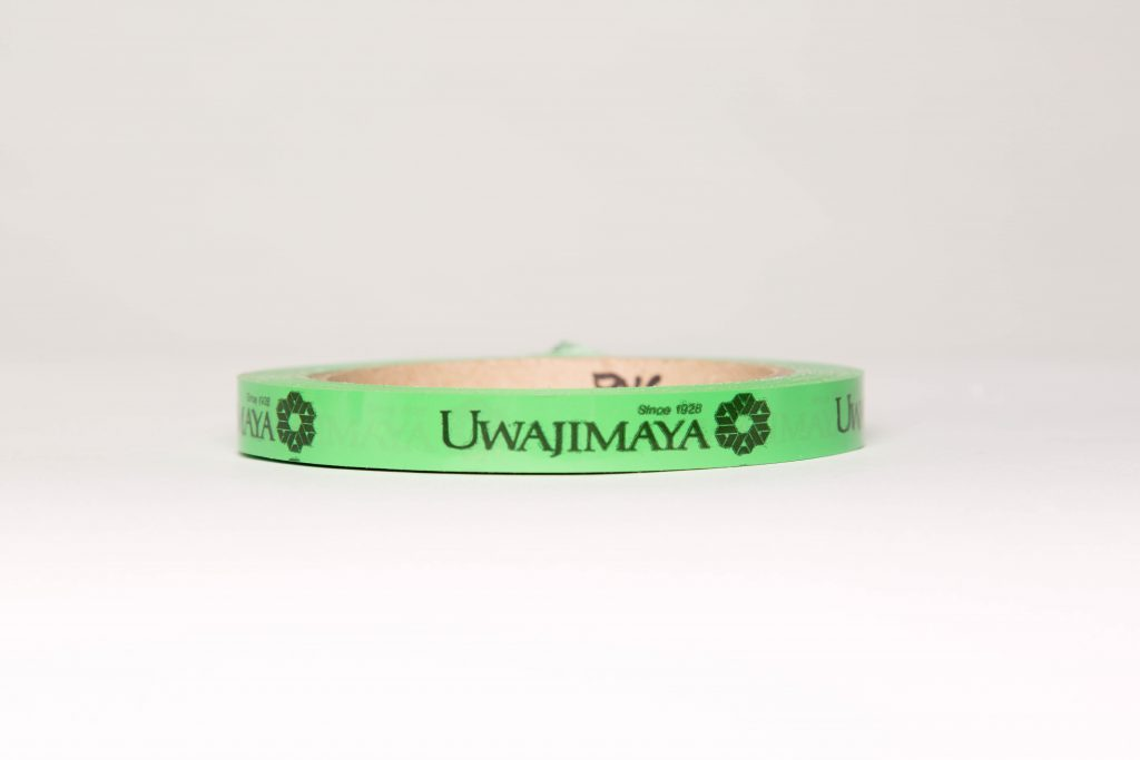 Green tape with logo